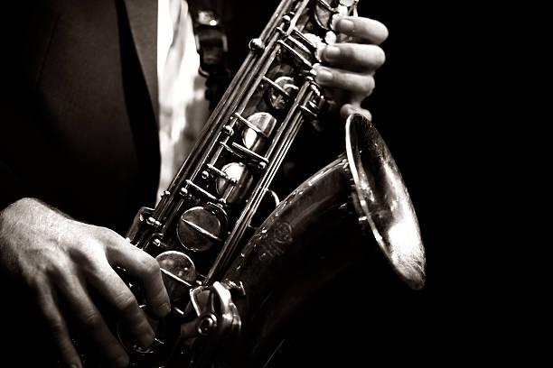 saxophone player - caz stok fotoğraflar ve resimler