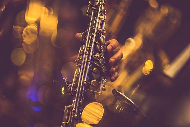 saxophone players - caz stok fotoğraflar ve resimler