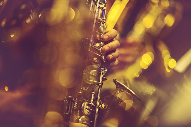 saxophone players playing live music - caz stok fotoğraflar ve resimler