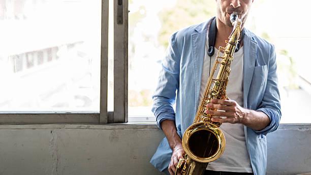 saxophone symphony musician jazz instrument concept - altsaxophon stock-fotos und bilder