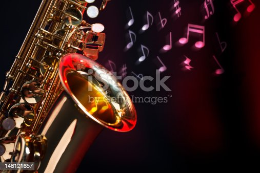 Motion-blurred musical notes rise out of the bell of an alto saxophone. Base image shot with Canon EOS 1Ds Mark III.