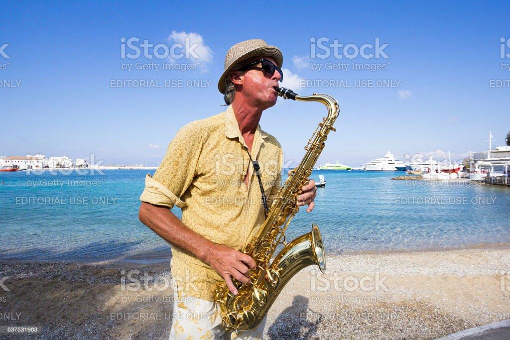 Saxophonist in Mykonos Town, Greece stock photo