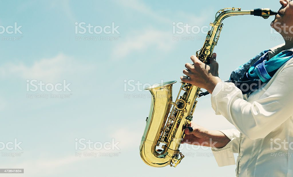 Saxophonist playing on saxophone stock photo