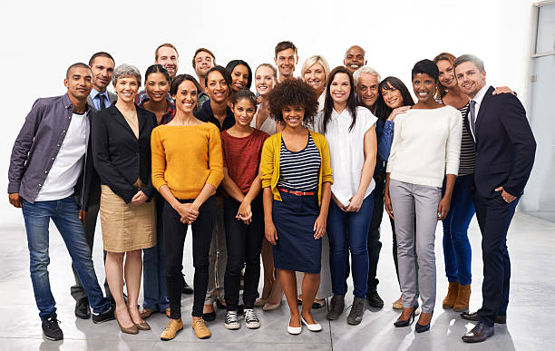 Say cheese for success Full length portrait of a diverse group of business professionals group corporate stock pictures, royalty-free photos & images