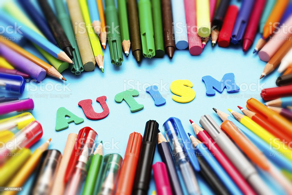 AUTISM say colorful play letters: art therapy may help stock photo