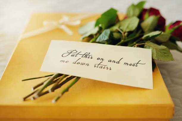 say i love you with a romantic surprise - gift tag note stock photos and pictures