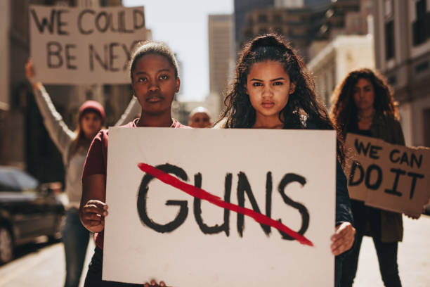 say no to guns - protestor stock pictures, royalty-free photos & images