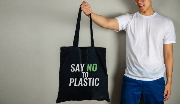 Say no to plastic text on tote bag carrying by man stock photo