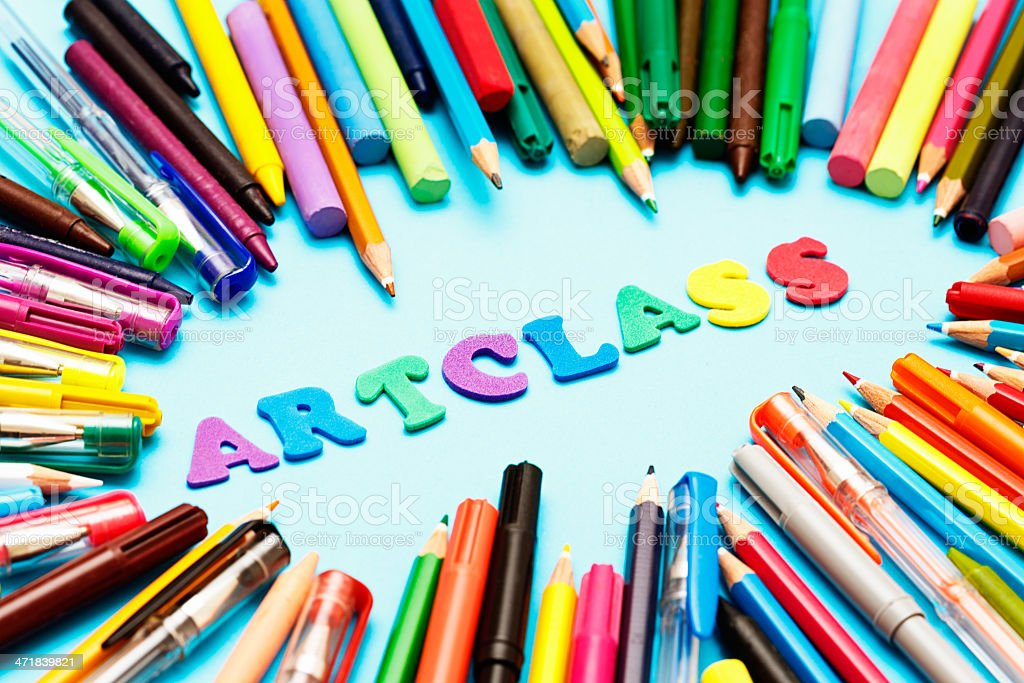 ART CLASS say play letters amongs many drawing materials royalty-free stock photo