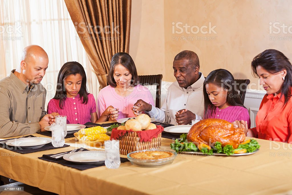 Saying grace before holiday dinner stock photo