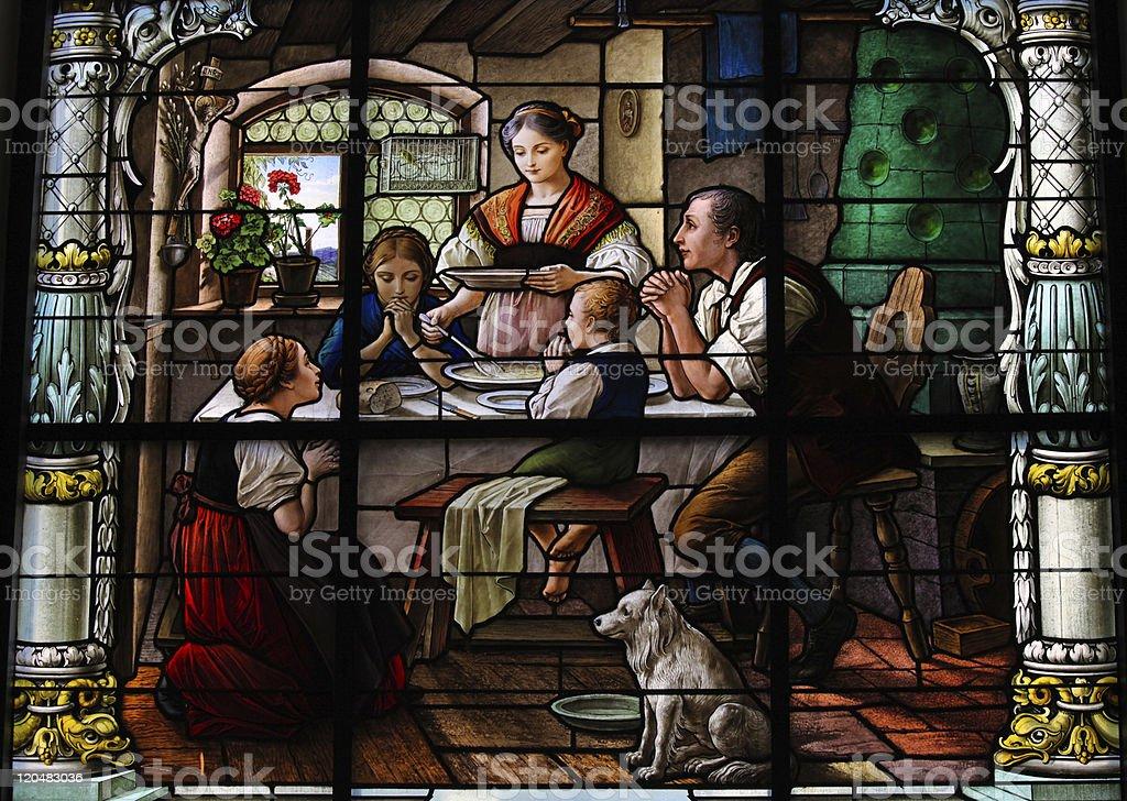 Saying grace -family dinner stock photo