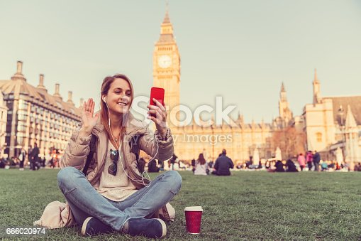 Smiling woman waving with hand on video call