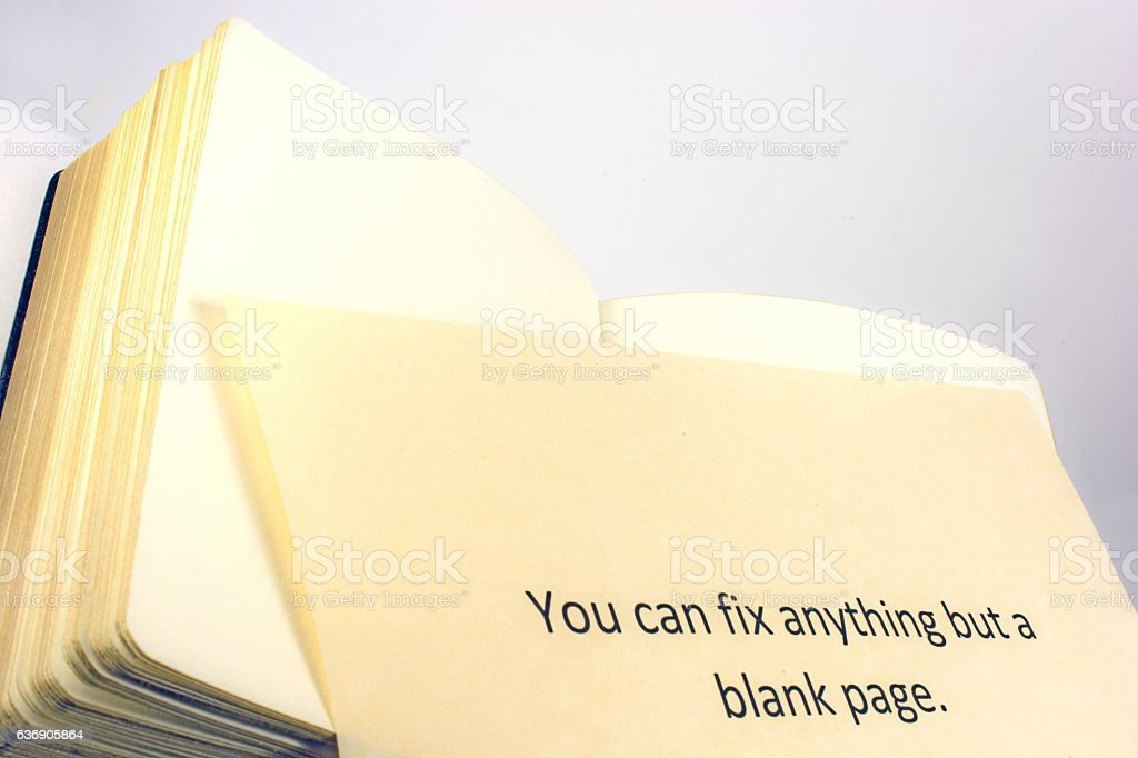 Saying- You can fix anything but a blank page- book stock photo
