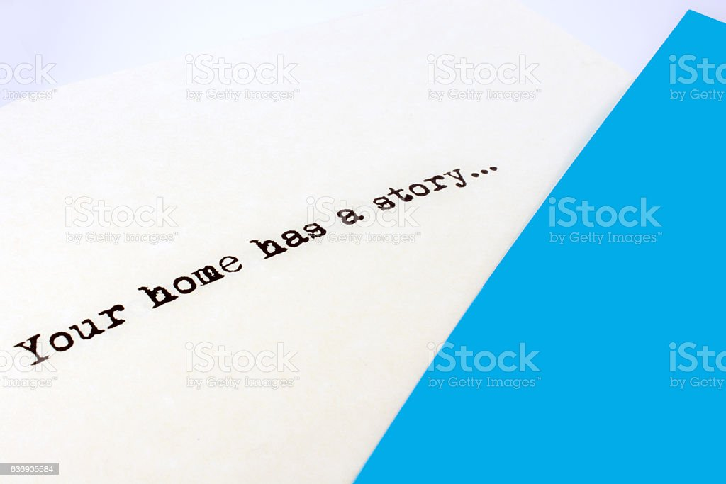Saying- Your home has a story- with blue and white stock photo