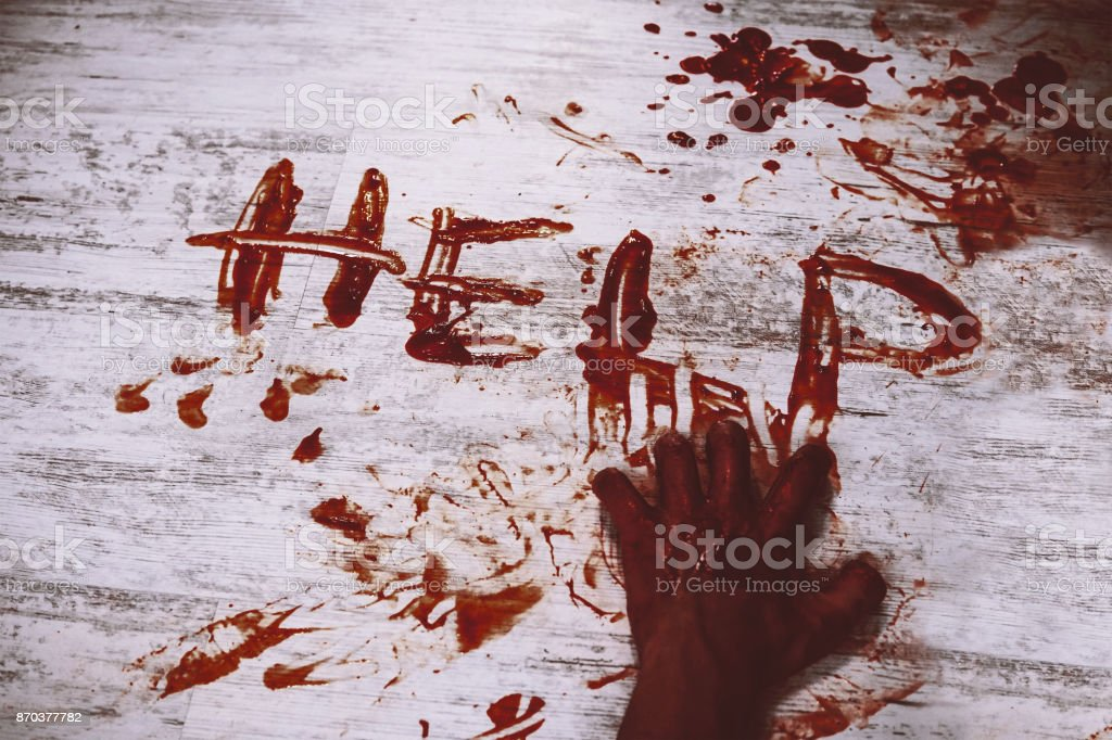 Says help, written in red blood stock photo