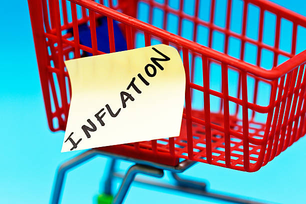 INFLATION says label on empty shopping cart: problems ahead! stock photo