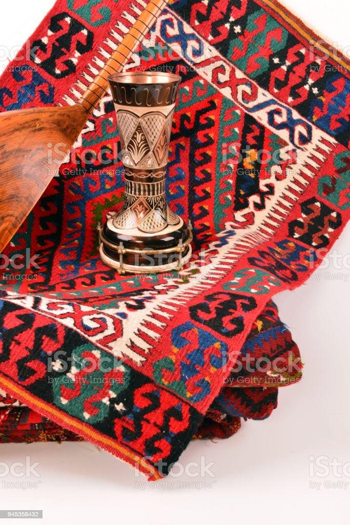 Saz baglama Turkish Music Instrument Isolated on kilim, stock photo