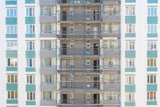 scaffold, apartment building under construction scaffold, apartment building under construction apparently stock pictures, royalty-free photos & images