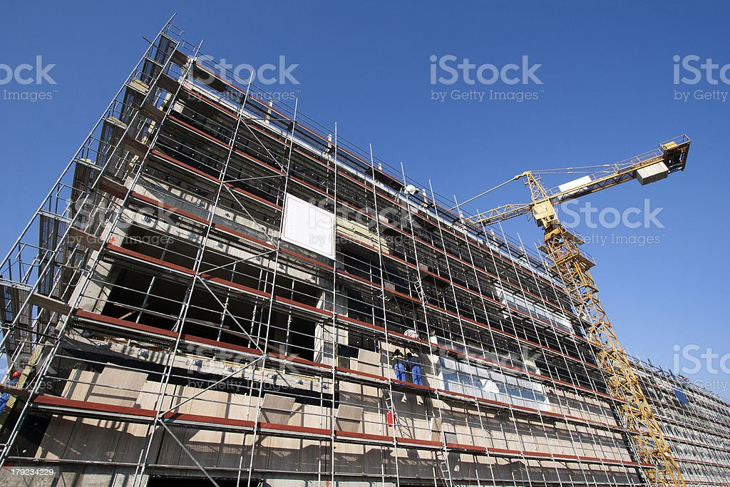 Scaffolding and crane royalty-free stock photo