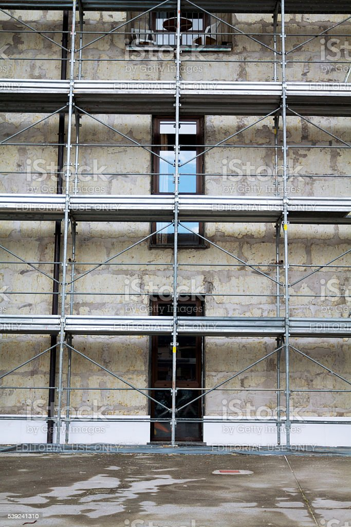 Scaffolding and restoring works of facade royalty-free stock photo