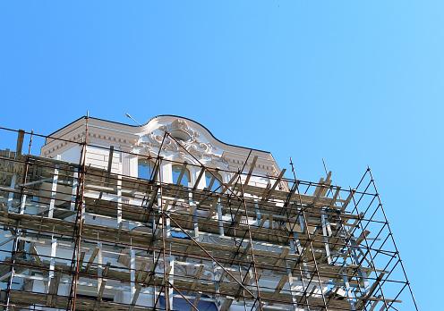 Scaffolding around a building renovating facade on Leningradskaya street, Samara city, Russia