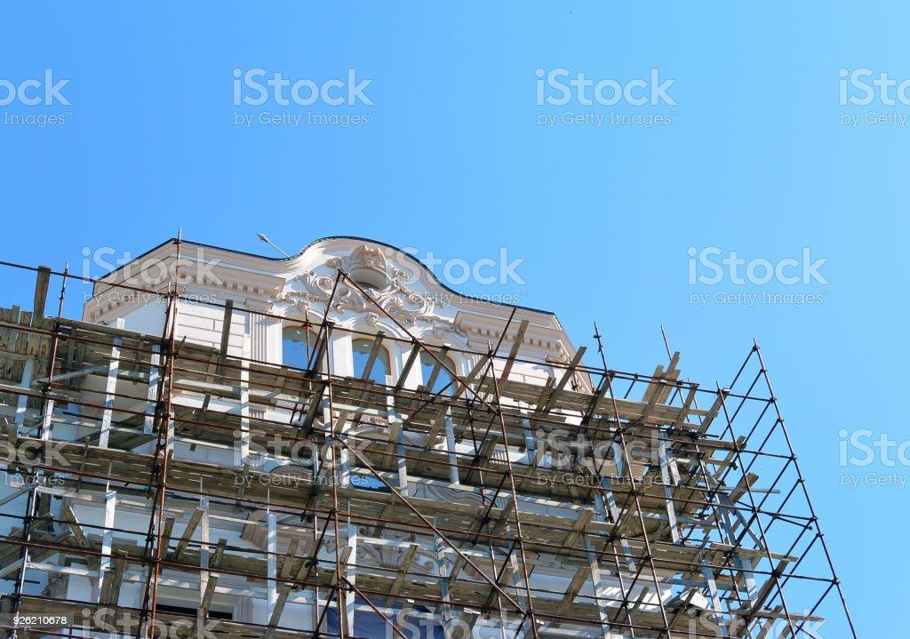 Scaffolding around a building renovating facade stock photo