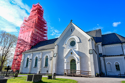 scaffolding around old church tower in Nykroppa Sweden april 29 2020