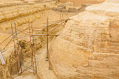 Scaffolding behind great Sphinx in Giza plateau. Cairo, Egypt