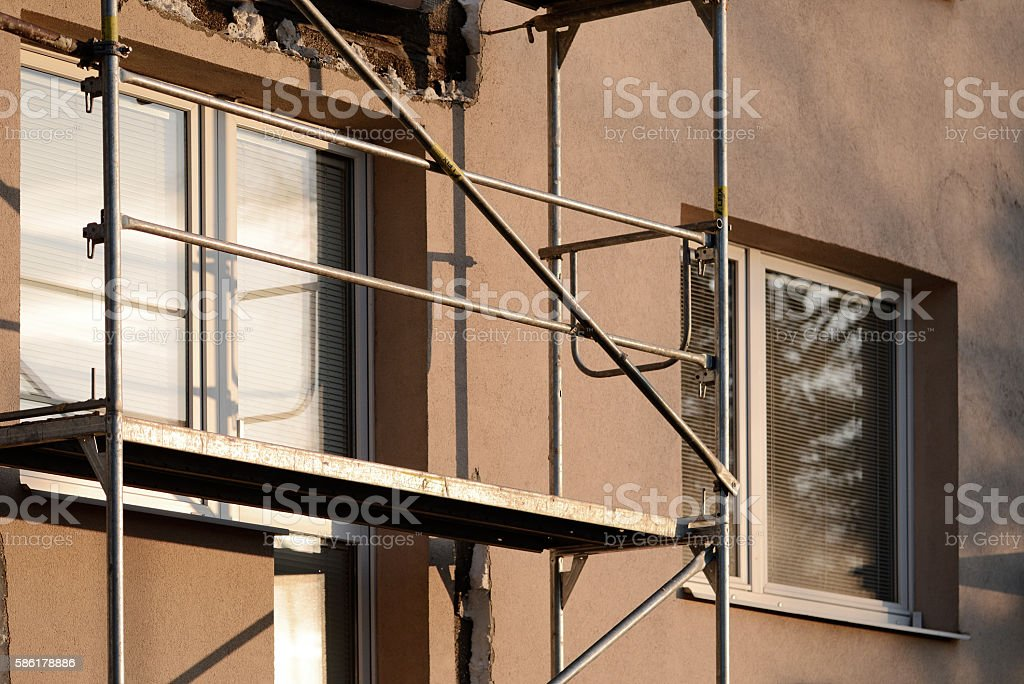 Scaffolding in building external thermo insulation protection stock photo