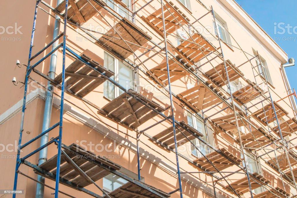 Scaffolding near the building bright sunny day blue sky stock photo