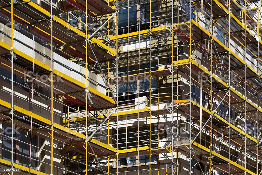 scaffolding on building , building facade with scaffolds royalty-free stock photo