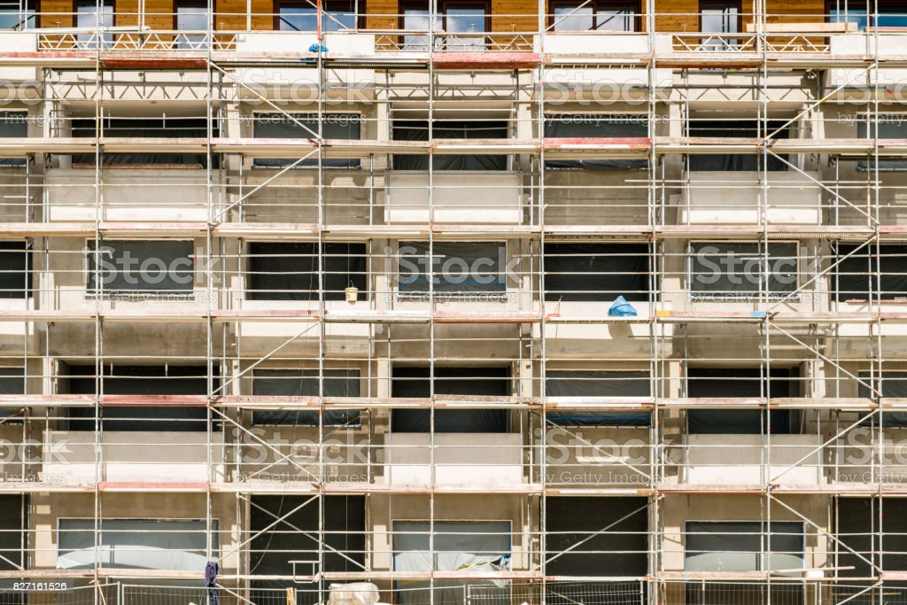 scaffolding on new building facade , construction site with framework on buiding stock photo