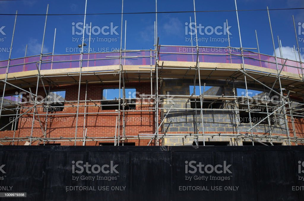 Bracknell, England - April 16, 2018: Scaffolding on the outside of an apartment block of new homes under construction in Bracknell, England stock photo