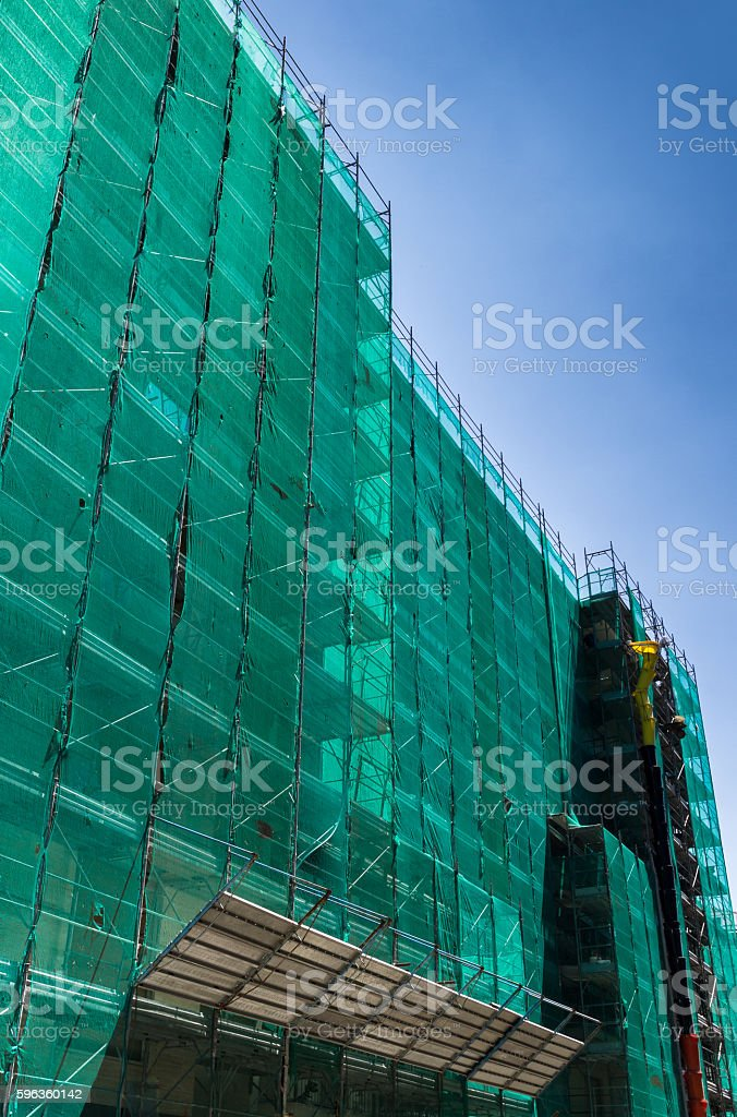 Scaffolding with green network royalty-free stock photo