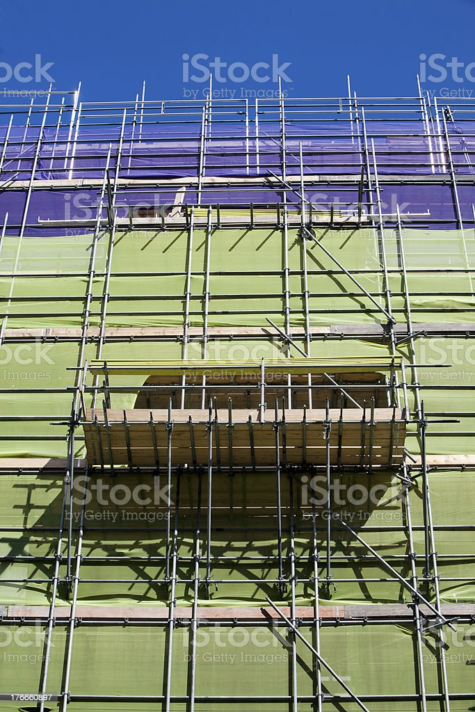 Scaffolding with protection nets royalty-free stock photo