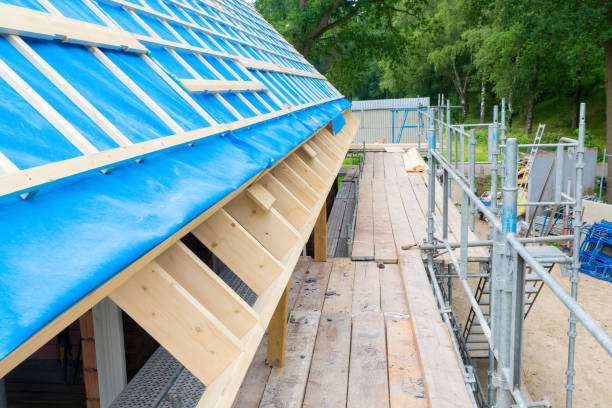 Scaffolding with roof of new house on construction site stock photo