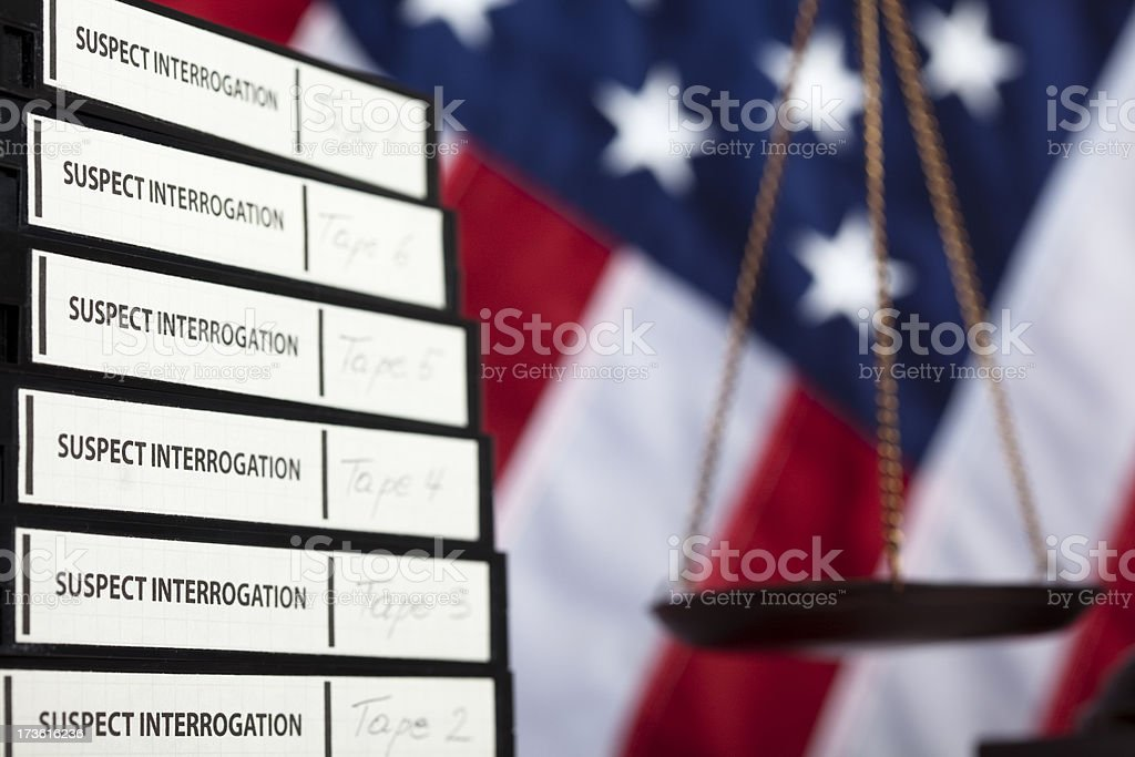 Scale aof justice and interrogation tapes royalty-free stock photo