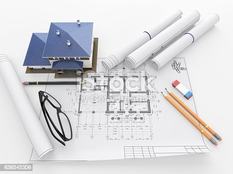 463026893 istock photo Scale model of house and architectural blueprints. 636545306