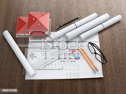 463026893 istock photo Scale model of house and architectural blueprints. 636545398