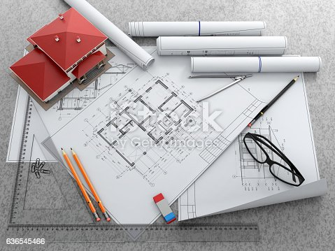 463026893 istock photo Scale model of house and architectural blueprints. 636545466