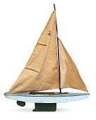 Scale model of old sailboat on white background