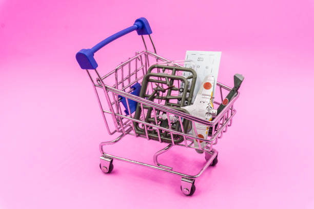 Scale Model shopping in shopping Cart on Pink pastel background stock photo