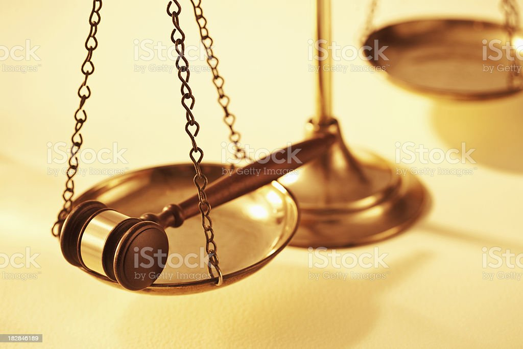 Scale of Justice Holding a Gavel stock photo
