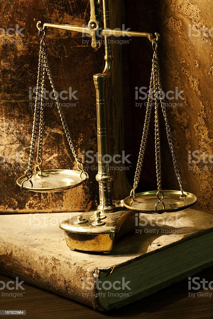 Scale of Justice surrounded by old books royalty-free stock photo