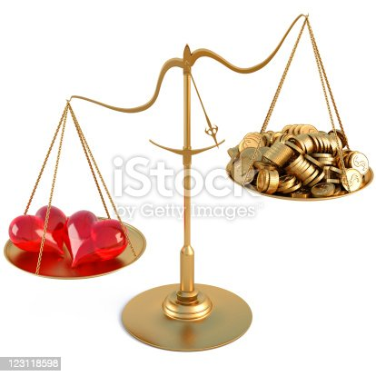 two loving hearts outweigh the pile of gold coins on the scale. isolated on white.