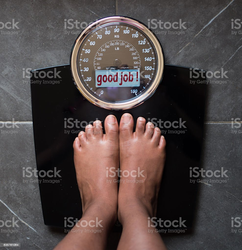 scale that tells the truth, good job! stock photo