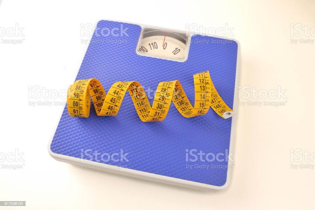 Scale with a tape measure stock photo