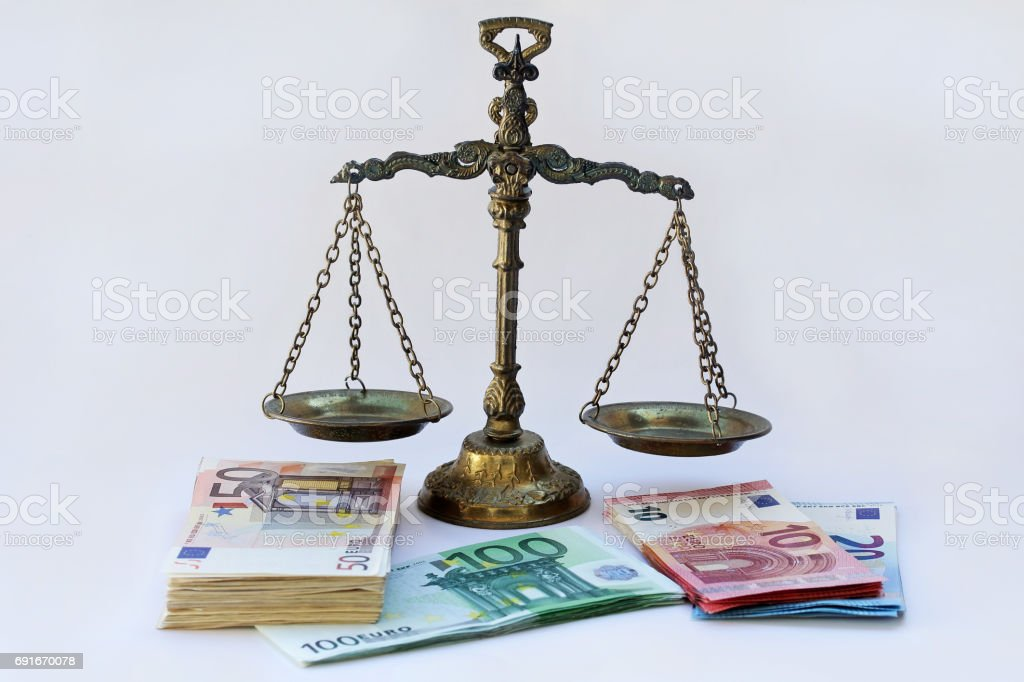 A scales and many euro notes stock photo