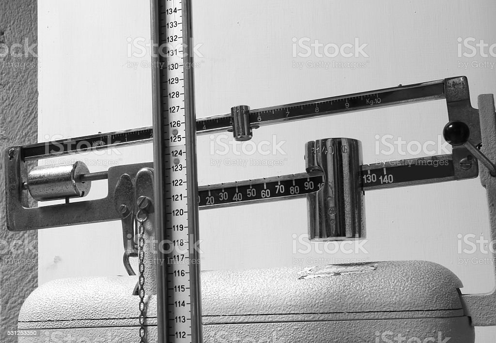 scales in the doctor's clinic to measure weight and height stock photo