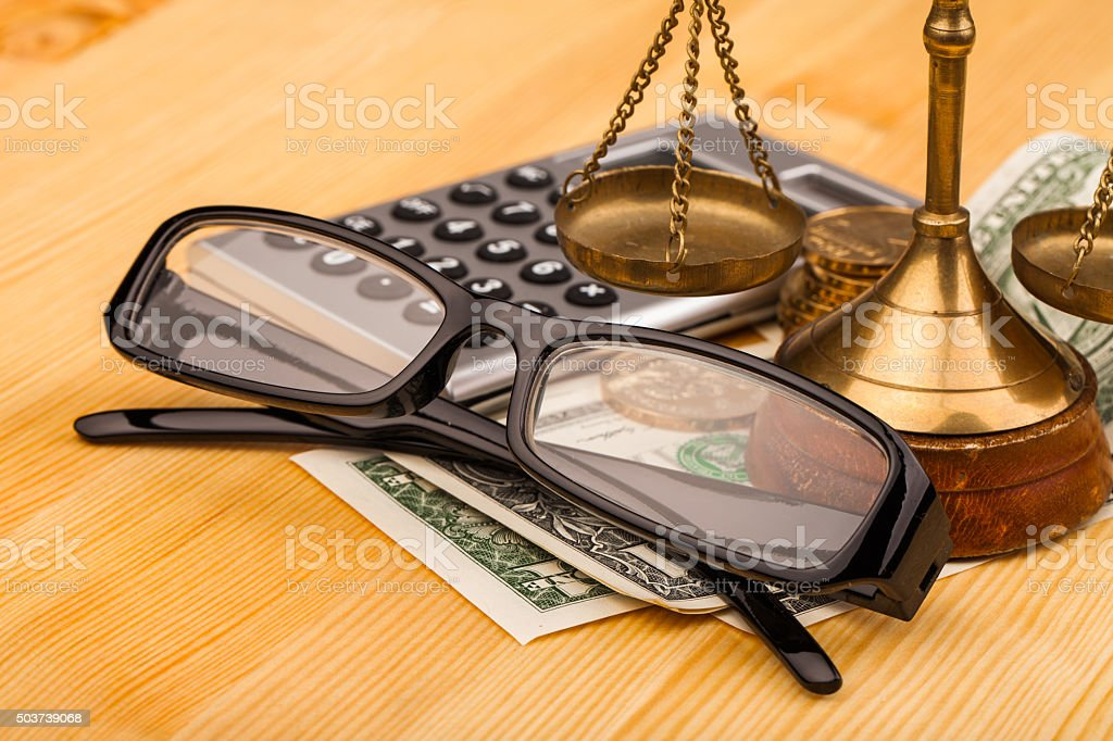 scales of justice  glasses and money stock photo